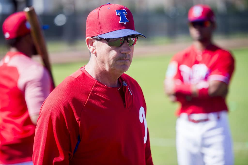 Phillies bench coach Rob Thomson watches players warm up as the Philidelphia Phillies gathered for their first full-team workout on Monday morning, February 19, 2018 at Spectrum Field in Clearwater, Florida.