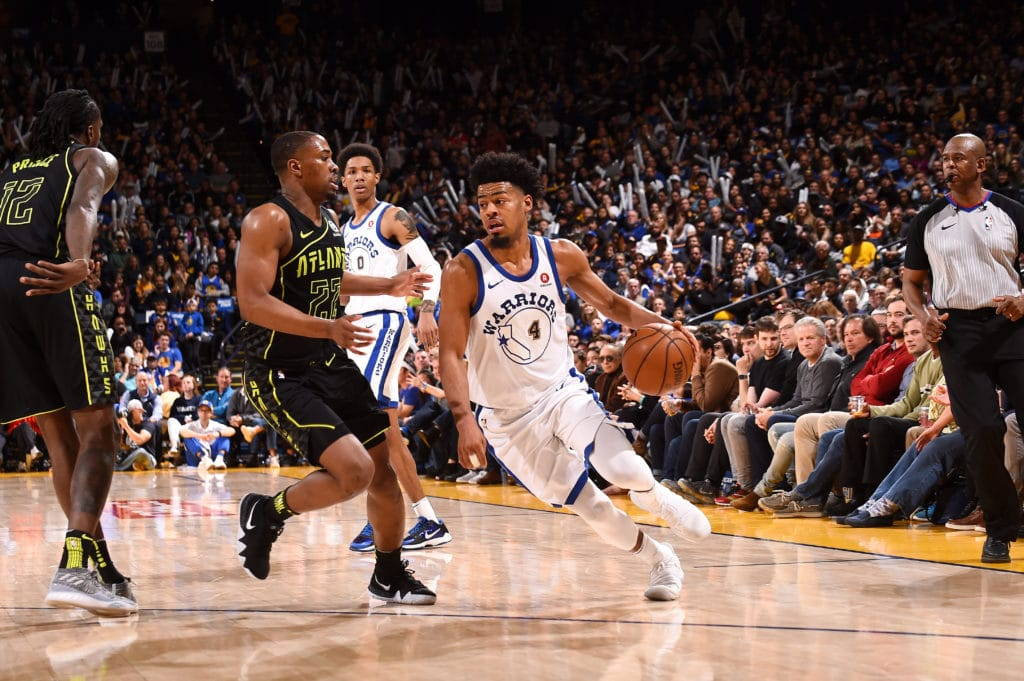 OAKLAND, CA - MARCH 23: Quinn Cook #4 of the Golden State Warriors handles the ball against the Atlanta Hawks on March 23, 2018 at ORACLE Arena in Oakland, California. NOTE TO USER: User expressly acknowledges and agrees that, by downloading and or using this photograph, user is consenting to the terms and conditions of Getty Images License Agreement. Mandatory Copyright Notice: Copyright 2018 NBAE (Photo by Noah Graham/NBAE via Getty Images)