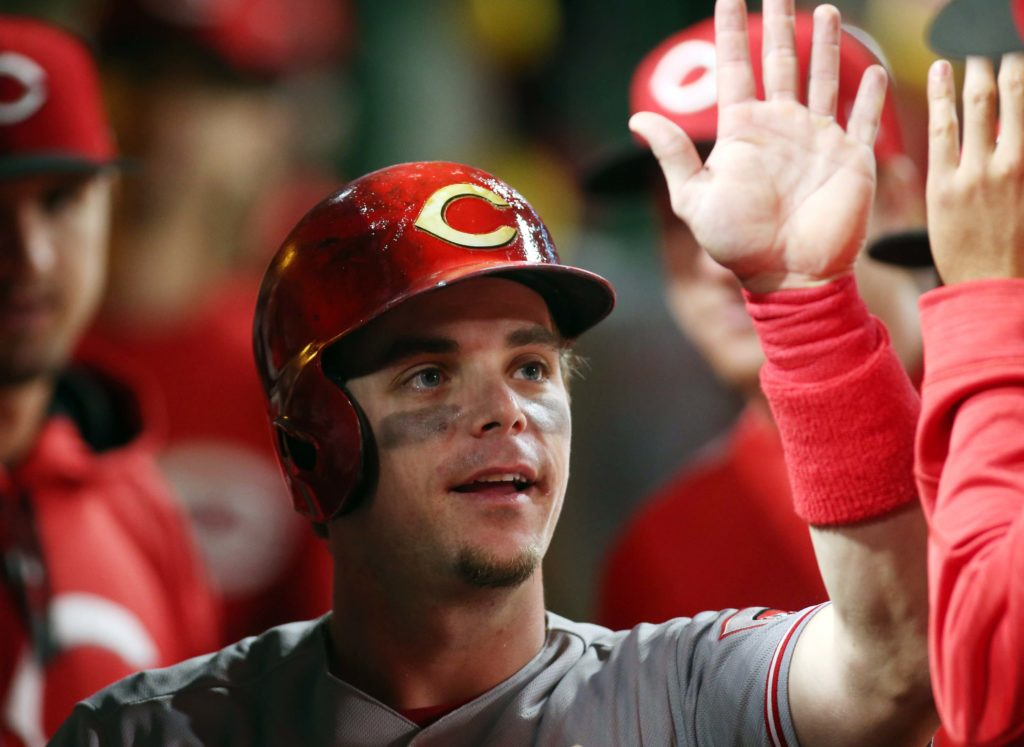 Sep 1, 2017; Pittsburgh, PA, USA;  Cincinnati Reds second baseman Scooter Gennett (4) high-fives in the dugout after scoring a run against the Pittsburgh Pirates during the sixth inning at PNC Park. Mandatory Credit: Charles LeClaire-USA TODAY Sports