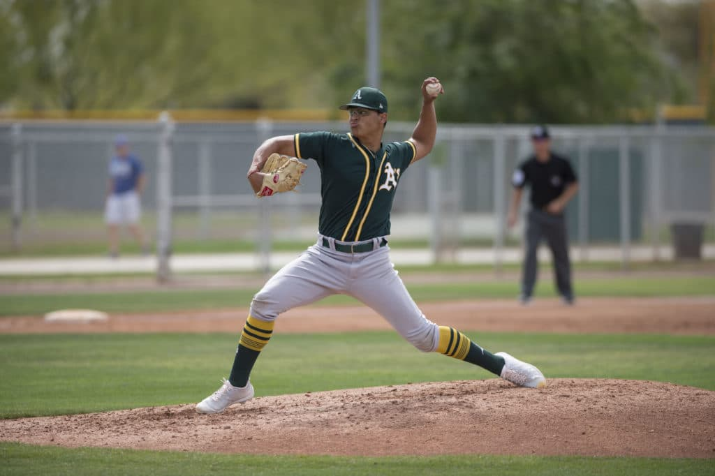 Oakland Athletics starting pitcher Jesus Luzardo (54) delivers a pitch to the plate during a Minor League Spring Training game against the Chicago Cubs at Sloan Park on March 13, 2018 in Mesa, Arizona. (Zachary Lucy/Four Seam Images via AP Images)
