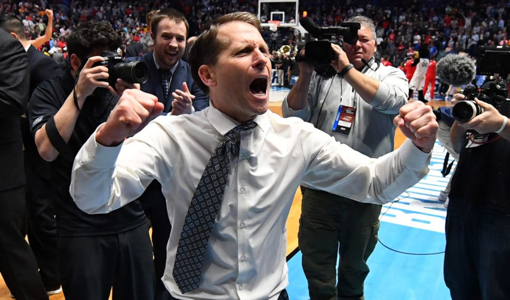 Mar 18, 2018; Nashville, TN, USA; Nevada Wolf Pack head coach Eric Musselman celebrates after defeating the Cincinnati Bearcats in the second round of the 2018 NCAA Tournament at Bridgestone Arena. Mandatory Credit: Christopher Hanewinckel-USA TODAY Sports