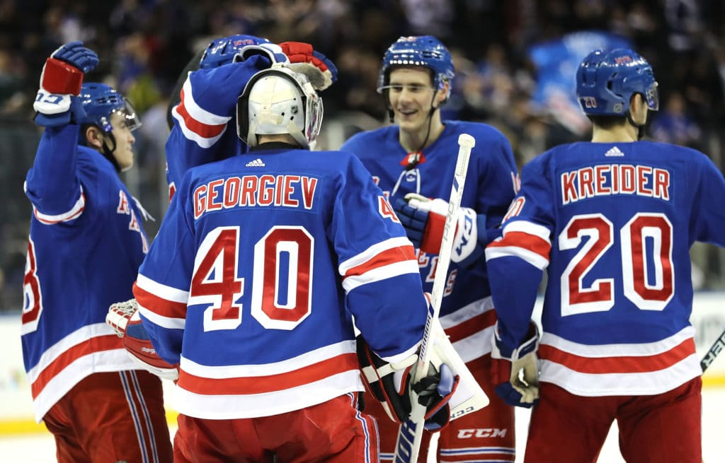 NEW YORK, NY - MARCH 24:  Alexandar Georgiev #40 of the New York Rangers celebrates with teammates following the Rangers' 5-1 win against the Buffalo Sabres during their game at Madison Square Garden on March 24, 2018 in New York City.  (Photo by Abbie Parr/Getty Images)
