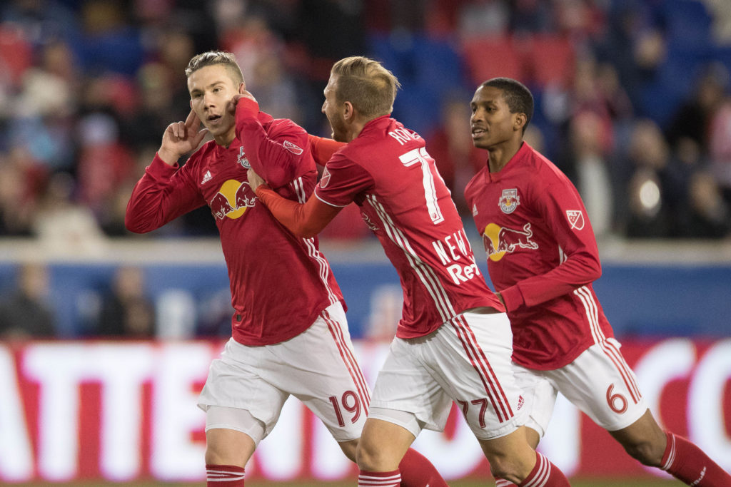 Mar 24, 2018; Harrison, NJ, USA;  New York Red Bulls midfielder Alex Muyl (19) celebrates his goal with midfielder Daniel Royer (77) and midfielder Kyle Duncan (6) during the first half against the Minnesota United at Red Bull Arena. Mandatory Credit: Vincent Carchietta-USA TODAY Sports