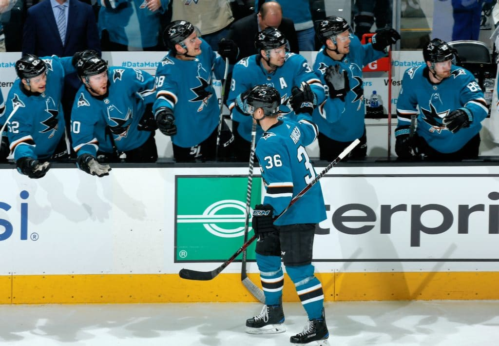 SAN JOSE, CA - MARCH 24: Jannik Hansen #36 of the San Jose Sharks celebrates his goal against the Calgary Flames with teammates at SAP Center on March 24, 2018 in San Jose, California. (Photo by Don Smith/NHLI via Getty Images) *** Local Caption *** Jannik Hansen