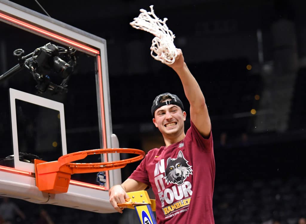 Mar 24, 2018; Atlanta, GA, USA; Loyola Ramblers guard Ben Richardson (14) cuts the net after defeating the Kansas State Wildcats in the championship game of the South regional of the 2018 NCAA Tournament at Philips Arena. Mandatory Credit: Dale Zanine-USA TODAY Sports