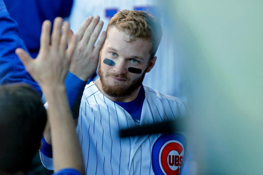 CHICAGO, IL - SEPTEMBER 30: Ian Happ #8 of the Chicago Cubs is congratulated in the dugout after scoring against the Cincinnati Reds during the third inning on a two run RBI single by Kyle Schwarber #12 (not pictured) at Wrigley Field on September 30, 2017 in Chicago, Illinois.  (Photo by Jon Durr/Getty Images)