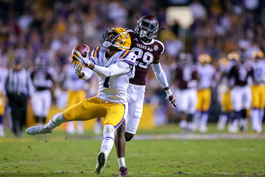 Nov 25, 2017; Baton Rouge, LA, USA; LSU Tigers wide receiver D.J. Chark (7) makes a 49 yard catch against Texas A&M Aggies defensive back Debione Renfro (29) at Tiger Stadium. Mandatory Credit: Stephen Lew-USA TODAY Sports