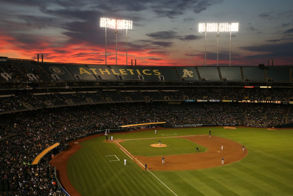 OAKLAND, CA - AUGUST 4:  Wide angle interior scenic view at sunset during the game between the Tampa Bay Rays and Oakland Athletics at O.co Coliseum on Monday, August 4, 2014 in Oakland, California. (Photo by Brad Mangin/MLB Photos via Getty Images)