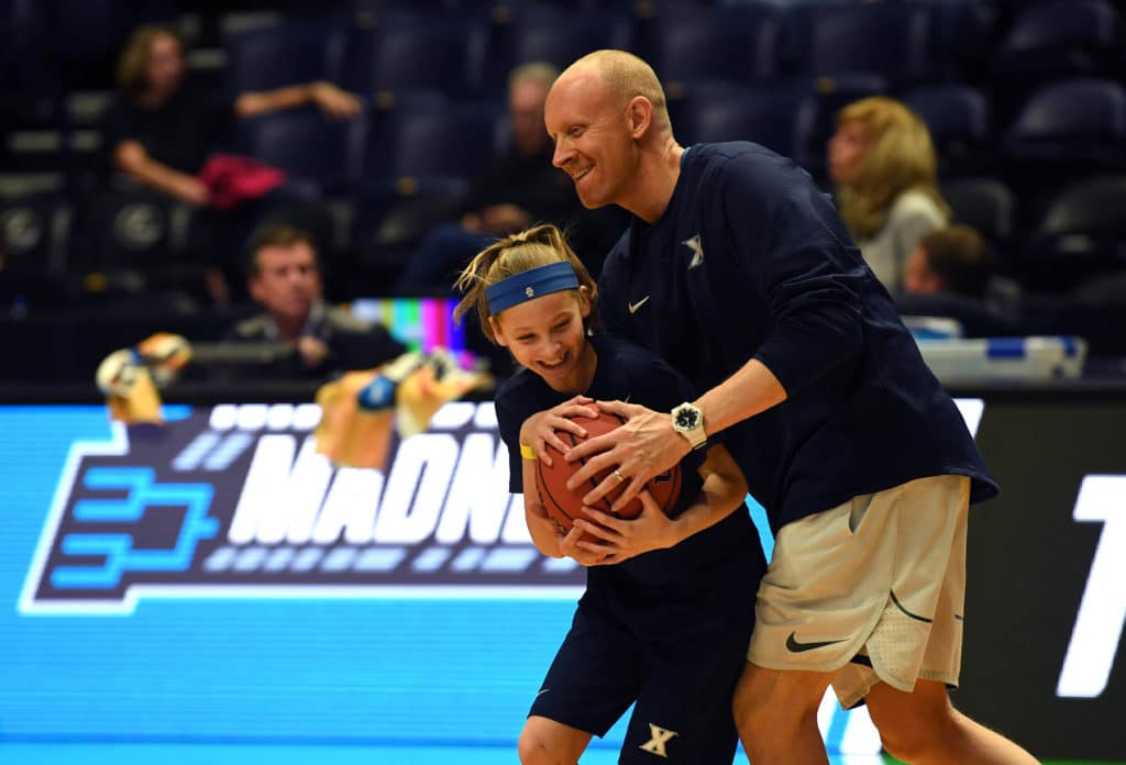 Mar 15, 2018; Nashville, TN, USA; Xavier Musketeers head coach Chris Mack looks on with his daughter Hailee Mack during practice the day before the first round of the 2018 NCAA Tournament at Bridgestone Arena. Mandatory Credit: Christopher Hanewinckel-USA TODAY Sports