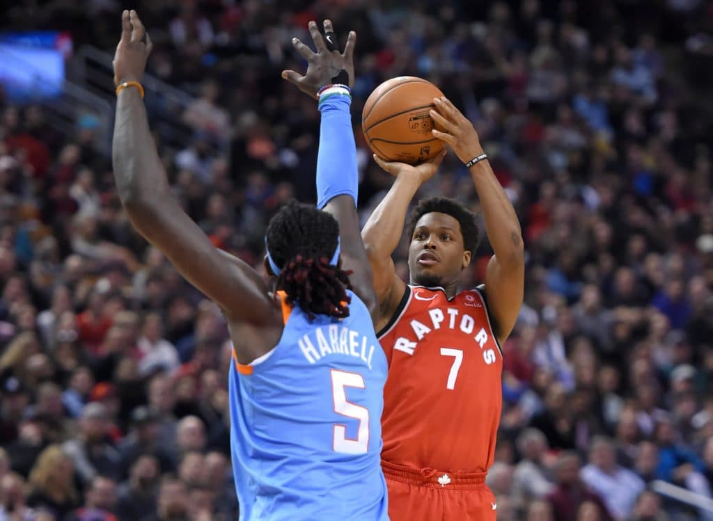 Mar 25, 2018; Toronto, Ontario, CAN;   Toronto Raptors guard Kyle Lowry (7) shoots for a basket against Los Angeles Clippers forward Montrezl Harrell (5) in the second half at Air Canada Centre. Mandatory Credit: Dan Hamilton-USA TODAY Sports