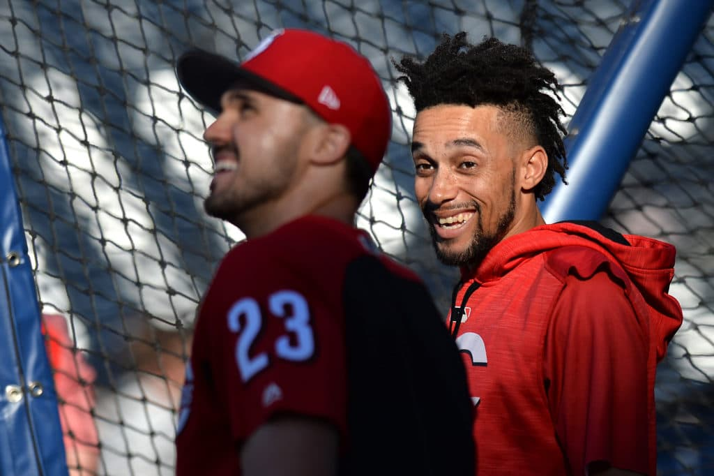 Jun 12, 2017; San Diego, CA, USA; Cincinnati Reds center fielder Billy Hamilton (right) and left fielder Adam Duvall (23) react before a game against the San Diego Padres at Petco Park. Mandatory Credit: Jake Roth-USA TODAY Sports