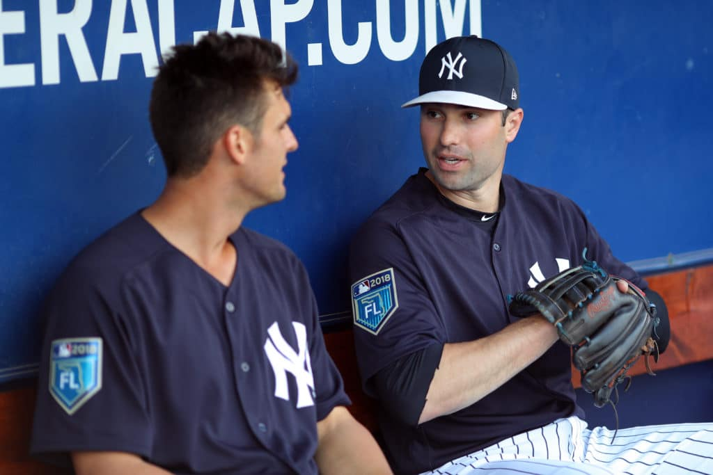TAMPA, FL - MARCH 19: Neil Walker #14 speaks with Greg Bird #33 of the New York Yankees in the dugout prior to a game against the Baltimore Orioles on Wednesday, March 21, 2018 at George M. Steinbrenner Field in Tampa, Florida.  (Photo by Alex Trautwig/MLB Photos via Getty Images)