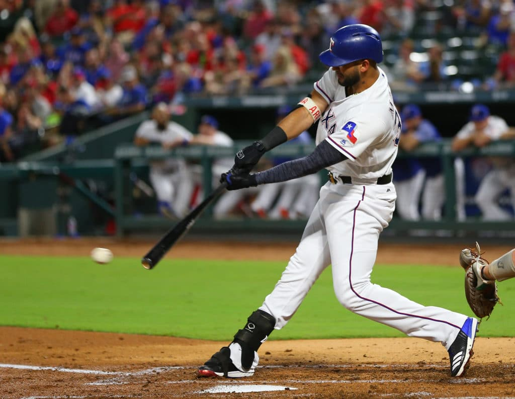 ARLINGTON, TX - SEPTEMBER 30: Nomar Mazara #30 of the Texas Rangers makes a base hit in the second inning against the Oakland Athletics at Globe Life Park in Arlington on September 30, 2017 in Arlington, Texas. (Photo by Rick Yeatts/Getty Images)