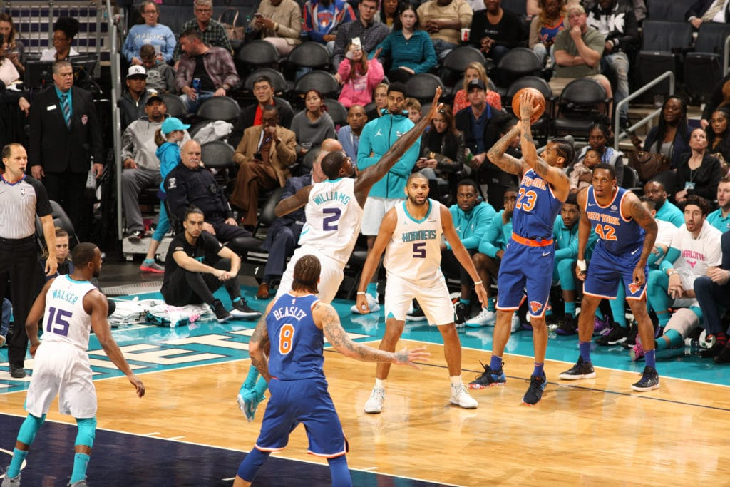 CHARLOTTE, NC - MARCH 26: Trey Burke #23 of the New York Knicks shoots the ball against the Charlotte Hornets on March 26, 2018 at Spectrum Center in Charlotte, North Carolina. NOTE TO USER: User expressly acknowledges and agrees that, by downloading and or using this photograph, User is consenting to the terms and conditions of the Getty Images License Agreement.  Mandatory Copyright Notice:  Copyright 2018 NBAE (Photo by Brock Williams-Smith/NBAE via Getty Images)