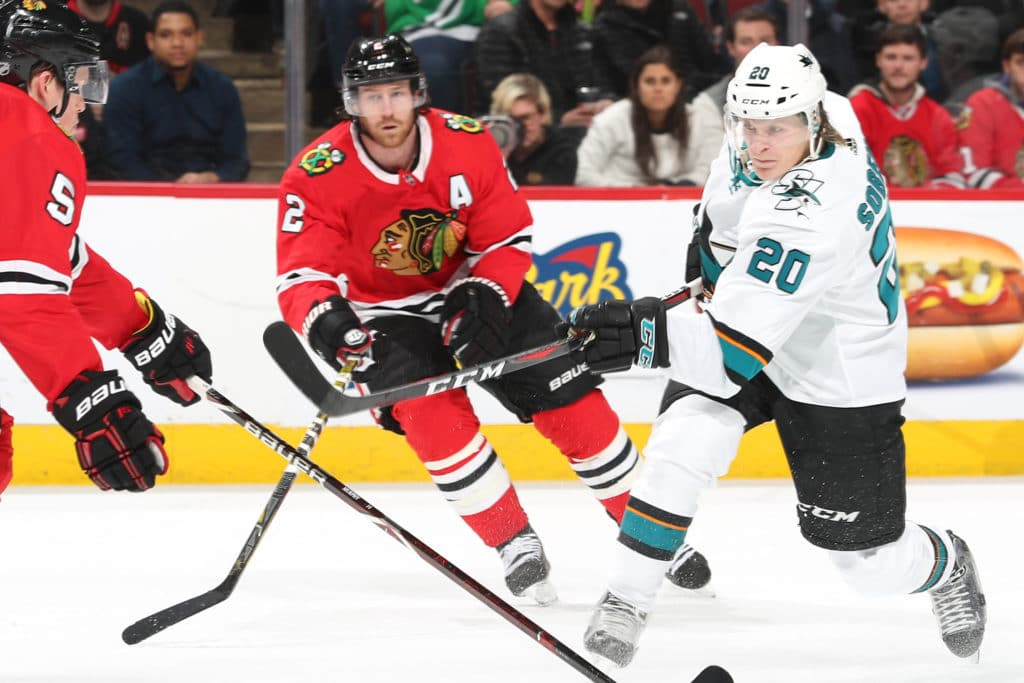 CHICAGO, IL - MARCH 26:  Marcus Sorensen #20 of the San Jose Sharks shoots against Connor Murphy #5 of the Chicago Blackhawks in the first period at the United Center on March 26, 2018 in Chicago, Illinois.  (Photo by Chase Agnello-Dean/NHLI via Getty Images)