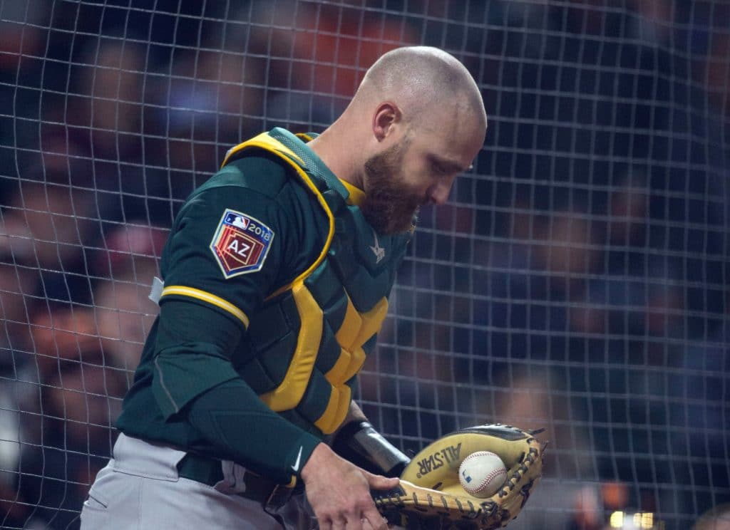 Mar 26, 2018; San Francisco, CA, USA; Oakland Athletics catcher Jonathan Lucroy (21) makes the catch at the screen behind home plate on San Francisco Giants catcher Buster Posey's foul pop in the inning of a Major League Baseball game at AT&T Park. Mandatory Credit: D. Ross Cameron-USA TODAY Sports