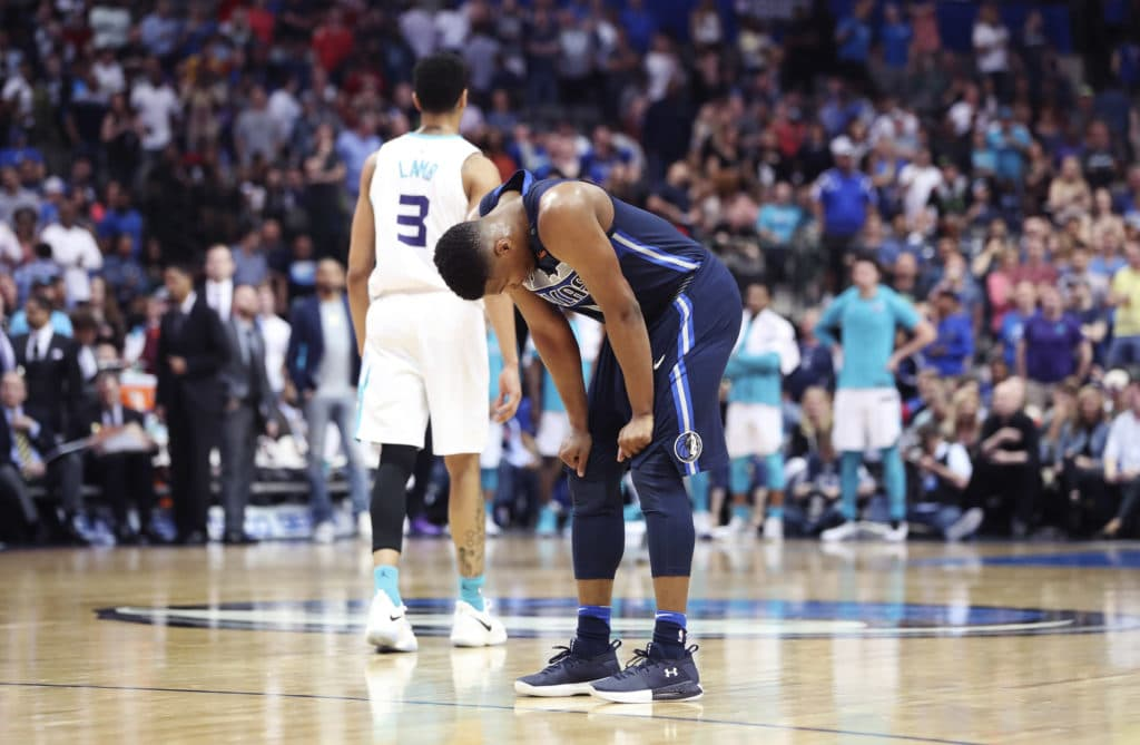 Mar 24, 2018; Dallas, TX, USA; Dallas Mavericks guard Dennis Smith Jr. (1) reacts in front of Charlotte Hornets guard Jeremy Lamb (3) during the fourth quarter at American Airlines Center. Mandatory Credit: Kevin Jairaj-USA TODAY Sports