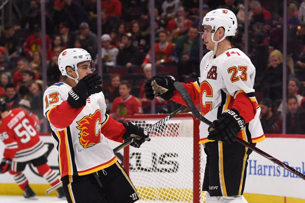 Feb 6, 2018; Chicago, IL, USA; Calgary Flames center Sean Monahan (23) celebrates his empty net goal with left wing Johnny Gaudreau (13) during the third period against the Chicago Blackhawks at the United Center. The Flames won 3-2. Mandatory Credit: Patrick Gorski-USA TODAY Sports