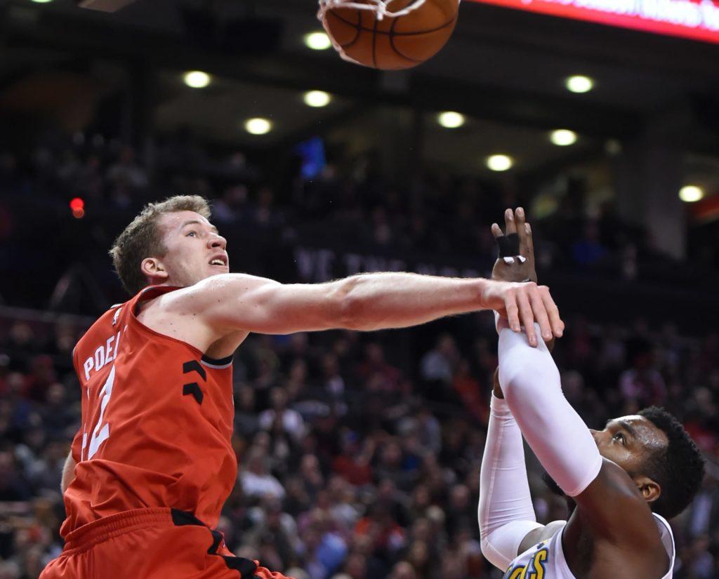 Mar 27, 2018; Toronto, Ontario, CAN; Toronto Raptors center Jakob Poeltl (42) dunks over Denver Nuggets forward Paul Millsap (4) in the second half at Air Canada Centre. Mandatory Credit: Dan Hamilton-USA TODAY Sports