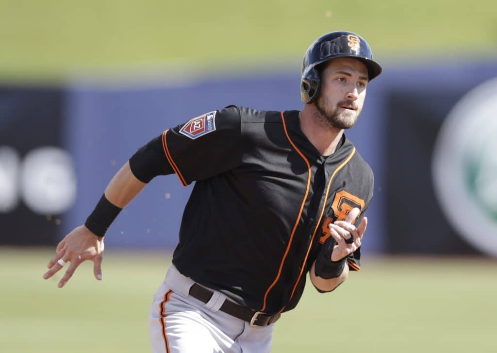 San Francisco Giants' Steven Duggar heads to third from first on a single by Brandon Crawford during the third inning of a spring training baseball game against the Milwaukee Brewers, Wednesday, Feb. 28, 2018, in Maryvale, Ariz. (AP Photo/Carlos Osorio)