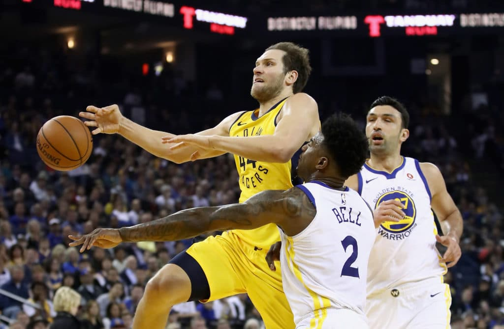OAKLAND, CA - MARCH 27:  Bojan Bogdanovic #44 of the Indiana Pacers looses control of the ball while guarded by Jordan Bell #2 of the Golden State Warriors at ORACLE Arena on March 27, 2018 in Oakland, California.  NOTE TO USER: User expressly acknowledges and agrees that, by downloading and or using this photograph, User is consenting to the terms and conditions of the Getty Images License Agreement.  (Photo by Ezra Shaw/Getty Images)