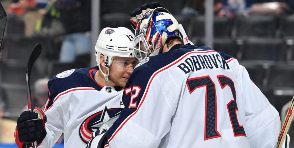 EDMONTON, AB - MARCH 27: Cam Atkinson #13 and Sergei Bobrovsky #72 of the Columbus Blue Jackets celebrate after winning the game against the Edmonton Oilers on March 27, 2018 at Rogers Place in Edmonton, Alberta, Canada. (Photo by Andy Devlin/NHLI via Getty Images)