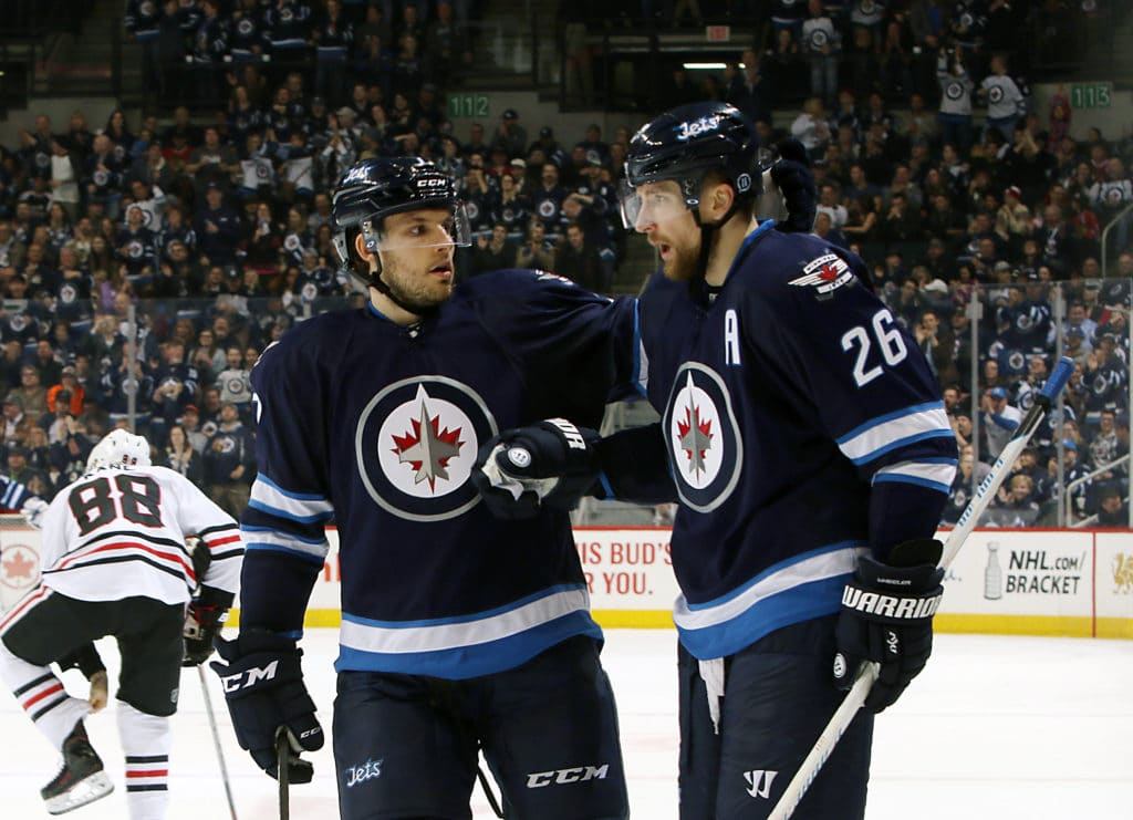 WINNIPEG, MB - APRIL 1: Blake Wheeler #26 of the Winnipeg Jets celebrates his second period goal against the Chicago Blackhawks with teammate Ben Chiarot #7 at the MTS Centre on April 1, 2016 in Winnipeg, Manitoba, Canada. (Photo by Jonathan Kozub/NHLI via Getty Images)