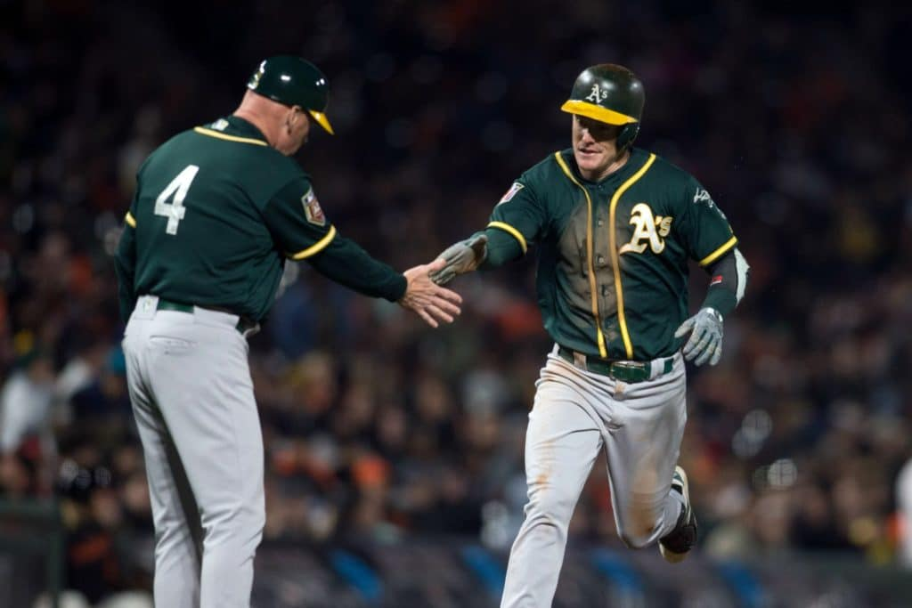 Mar 26, 2018; San Francisco, CA, USA; Oakland Athletics first baseman Mark Canha, right, gets a congratulatory handshake from third base coach Matt Williams after hitting a solo home run against the San Francisco Giants in the fifth inning of a Major League Baseball game at AT&T Park. Mandatory Credit: D. Ross Cameron-USA TODAY Sports