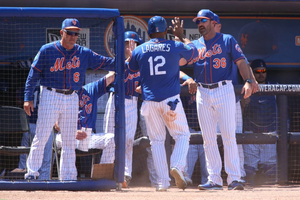 PORT ST. LUCIE, FL - MARCH 23: Juan Lagares #12 is congratulated by hitting coach Pat Roessler #6 and Manager Mickey Callaway #36 of the New York Mets after scoring against the St Louis Cardinals on a hit by Andres Gimenez #84 during the fifth inning of a spring training game at First Data Field on March 23, 2018 in Port St. Lucie, Florida. The Cardinals defeated the Mets 5-1. (Photo by Joel Auerbach/Getty Images)