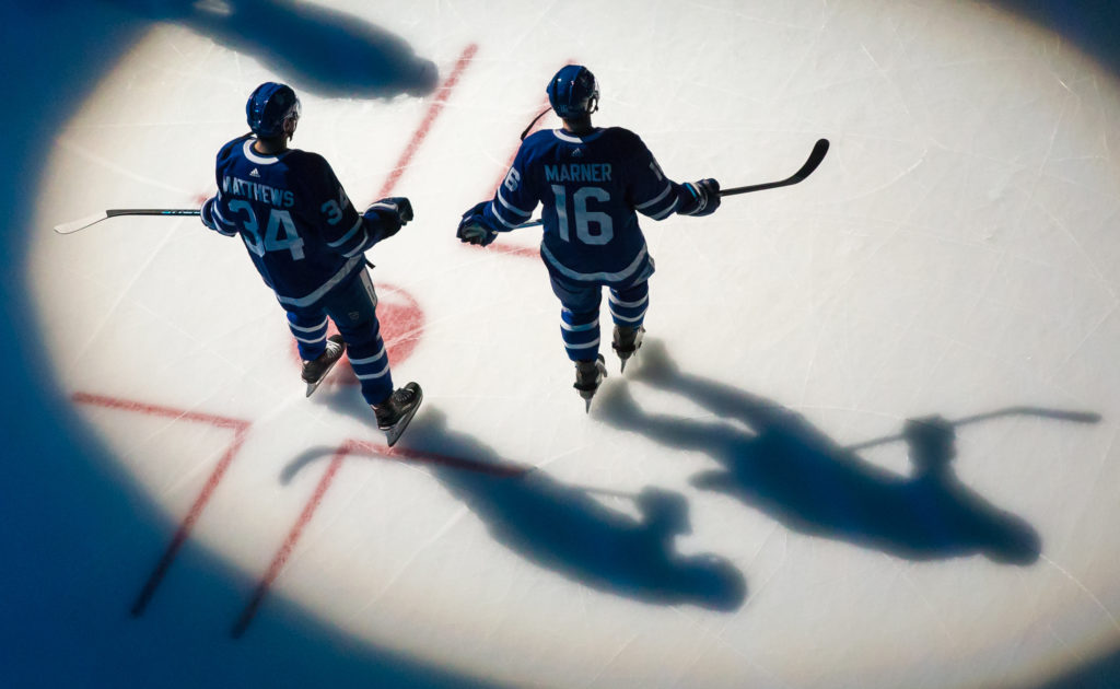 TORONTO, ON - JANUARY 2: Auston Matthews #34 and Mitchell Marner #16 of the Toronto Maple Leafs take the ice during introductions prior to the game against the Tampa Bay Lightning at the Air Canada Centre on January 2, 2018 in Toronto, Ontario, Canada. (Photo by Kevin Sousa/NHLI via Getty Images)