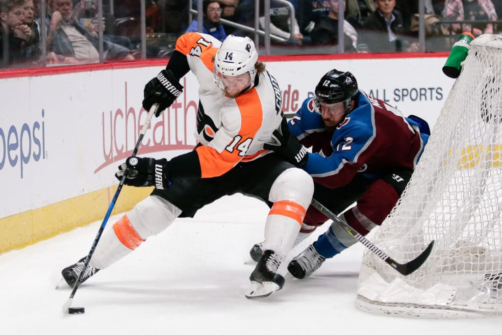 Mar 28, 2018; Denver, CO, USA; Philadelphia Flyers center Sean Couturier (14) controls the puck as Colorado Avalanche defenseman Patrik Nemeth (12) defends in the first period at the Pepsi Center. Mandatory Credit: Isaiah J. Downing-USA TODAY Sports