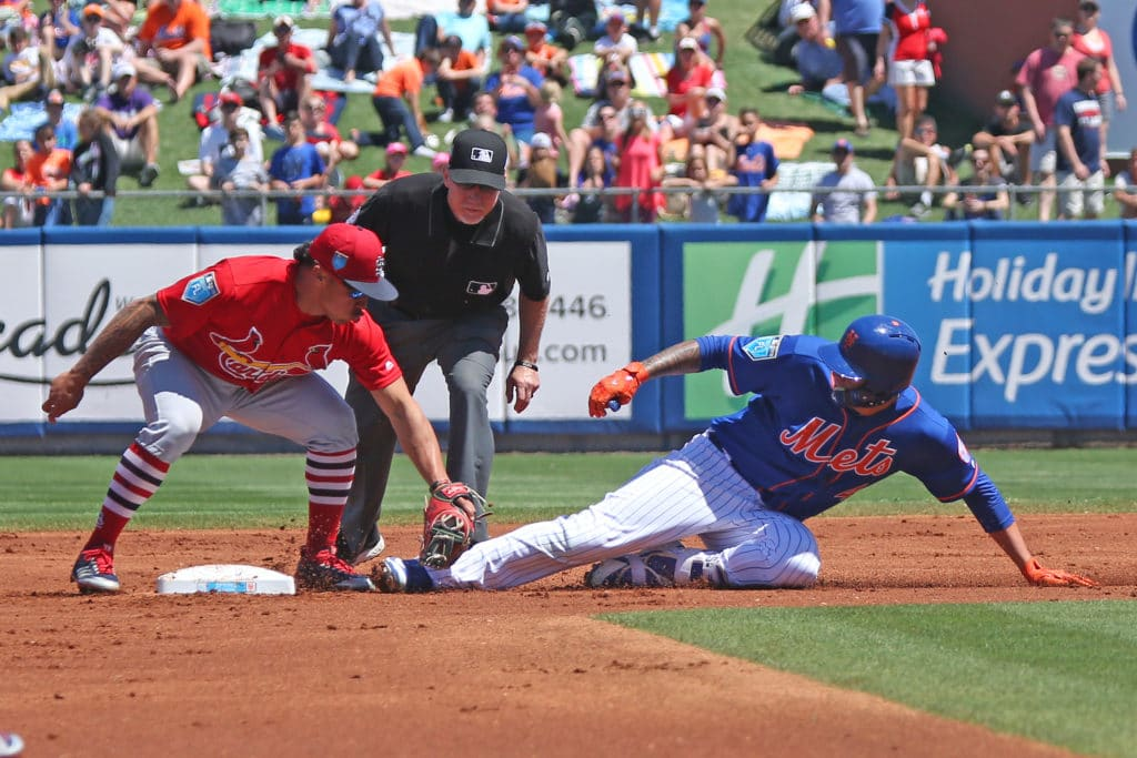 PORT ST. LUCIE, FL - MARCH 23: Kolten Wong #16 of the St Louis Cardinals tags out Wilmer Flores #4 of the New York Mets as eh attempts to stretch a single into a double during a spring training game at First Data Field on March 23, 2018 in Port St. Lucie, Florida. The Cardinals defeated the Mets 5-1. (Photo by Joel Auerbach/Getty Images)