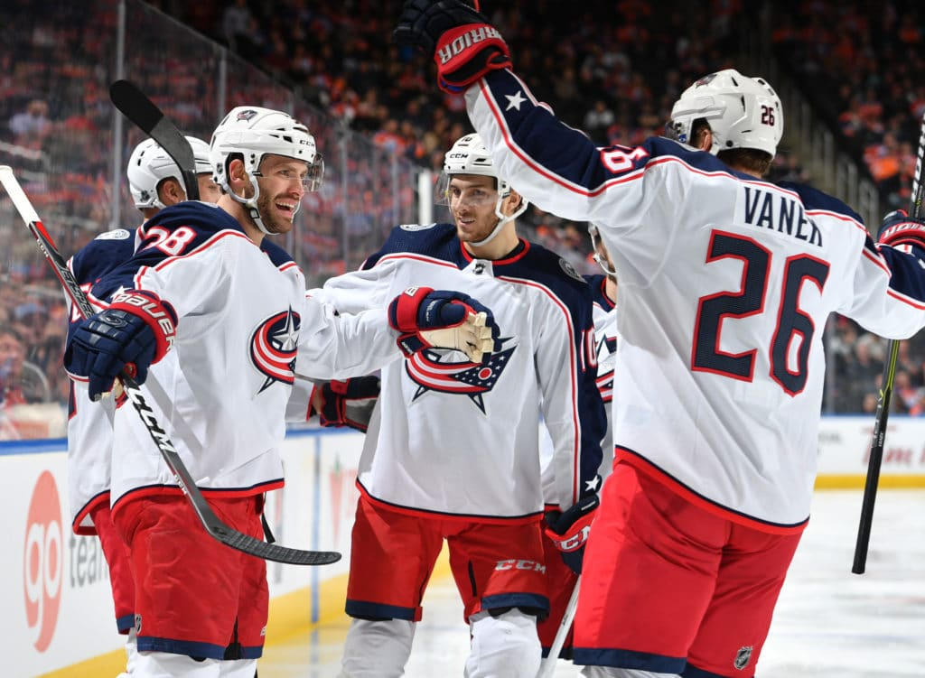 EDMONTON, AB - MARCH 27: Thomas Vanek #26, Boone Jenner #38 and Alexander Wennberg #10 of the Columbus Blue Jackets celebrate after a goal during the game against the Edmonton Oilers on March 27, 2018 at Rogers Place in Edmonton, Alberta, Canada. (Photo by Andy Devlin/NHLI via Getty Images)