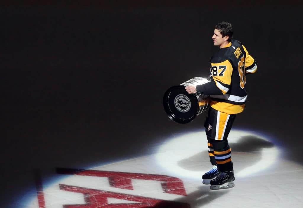 Oct 4, 2017; Pittsburgh, PA, USA;  Pittsburgh Penguins center Sidney Crosby (87) carries the Stanley Cup onto the ice during the 2017 banner raising ceremony before a game against the St. Louis Blues at PPG PAINTS Arena. Mandatory Credit: Charles LeClaire-USA TODAY Sports