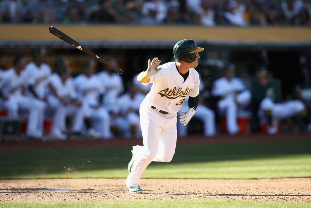 OAKLAND, CA - MARCH 29:  Boog Powell #3 of the Oakland Athletics hits a triple in the 11th inning against the Los Angeles Angels at Oakland Alameda Coliseum on March 29, 2018 in Oakland, California.  He scored the winning run later in the inning. (Photo by Ezra Shaw/Getty Images)
