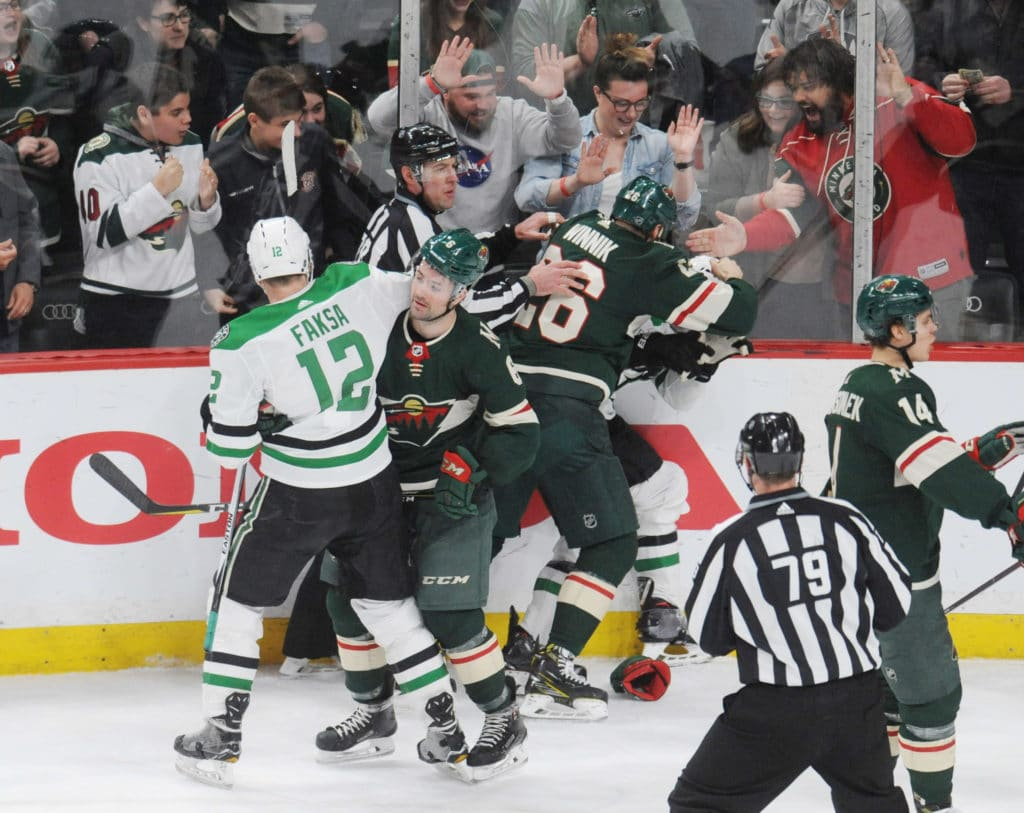 Mar 29, 2018; Saint Paul, MN, USA; Minnesota Wild forward Daniel Winnik (26) and Dallas Stars forward Antoine Roussel (21) drop gloves to fight as the clock runs out on a 6-1 Wild victory at Xcel Energy Center. Mandatory Credit: Marilyn Indahl-USA TODAY Sports