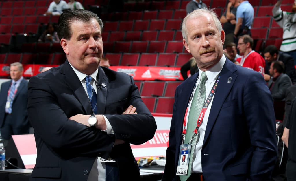 CHICAGO, IL - JUNE 23:  Vancouver Canucks general manager Jim Benning meets with Dallas Stars general manager Jim Nill during the 2017 NHL Draft at the United Center on June 23, 2017 in Chicago, Illinois.  (Photo by Bruce Bennett/Getty Images)