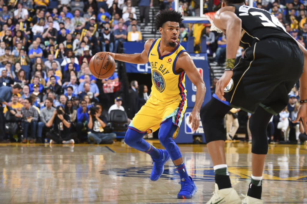 OAKLAND, CA - MARCH 29: Quinn Cook #4 of the Golden State Warriors handles the ball during the game against the Milwaukee Bucks on March 29, 2018 at ORACLE Arena in Oakland, California. NOTE TO USER: User expressly acknowledges and agrees that, by downloading and/or using this Photograph, user is consenting to the terms and conditions of the Getty Images License Agreement. Mandatory Copyright Notice: Copyright 2018 NBAE (Photo by Andrew D. Bernstein/NBAE via Getty Images)