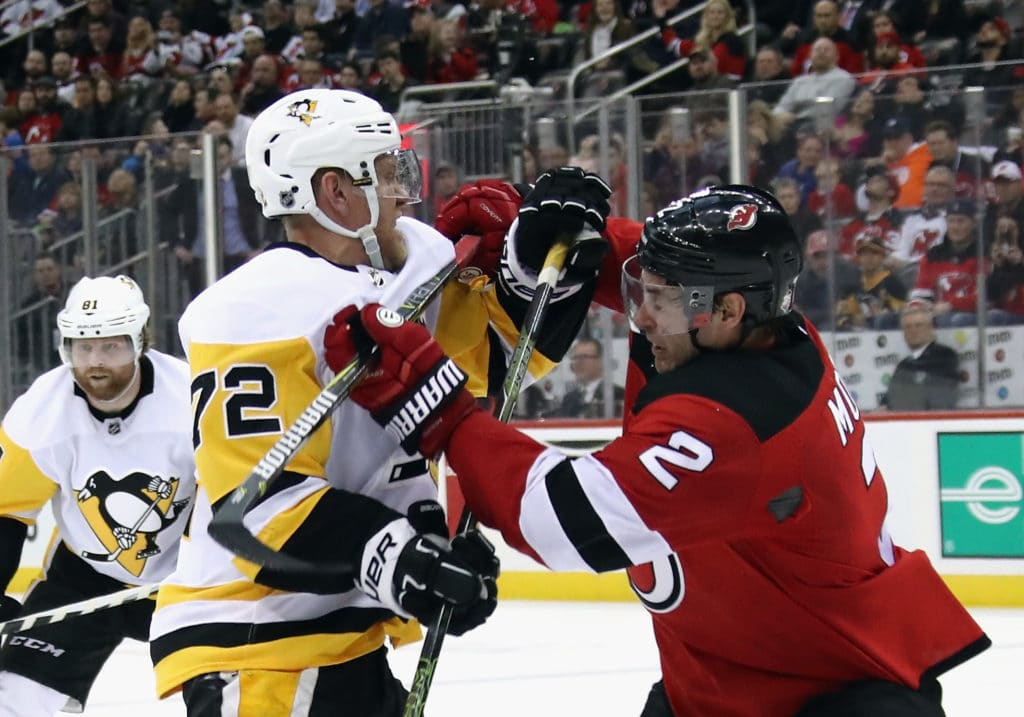 NEWARK, NJ - MARCH 29: Patric Hornqvist #72 of the Pittsburgh Penguins skates against John Moore #2 of the New Jersey Devils at the Prudential Center on March 29, 2018 in Newark, New Jersey. The Penguins defeated the Devils 4-3 in overtime.  (Photo by Bruce Bennett/Getty Images)