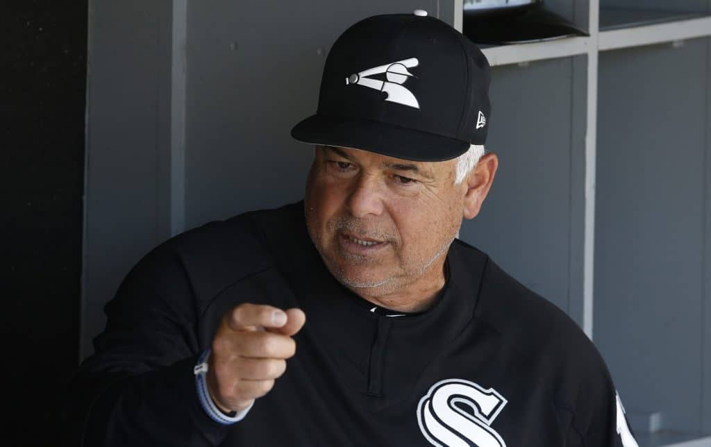 Chicago White Sox manager Rick Renteria talks with other coaches in the dugout prior to the team's spring training baseball game against the Texas Rangers on Tuesday, March 20, 2018, in Glendale, Ariz. The White Sox defeated the Rangers 10-0. (AP Photo/Ross D. Franklin)