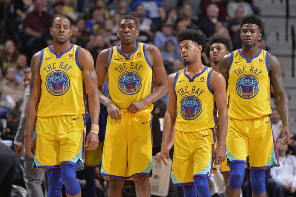 SAN ANTONIO, TX - MARCH 19: Andre Iguodala #9, Kevon Looney #5, Quinn Cook #4, and Jordan Bell #2 of the Golden State Warriors during the game against the San Antonio Spurs on March 19, 2018 at the AT&T Center in San Antonio, Texas. NOTE TO USER: User expressly acknowledges and agrees that, by downloading and or using this photograph, user is consenting to the terms and conditions of the Getty Images License Agreement. Mandatory Copyright Notice: Copyright 2018 NBAE (Photos by Mark Sobhani/NBAE via Getty Images)
