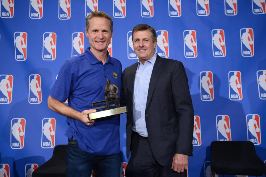 OAKLAND, CA - APRIL 26:  Head Coach Steve Kerr and President of Basketball Operations Rick Welts of the Golden State Warriors poses with the Red Auerbach Trophy as the 2015-16 NBA Coach of the Year on April 26, 2016 at the Warriors practice facility in Oakland, California. NOTE TO USER: User expressly acknowledges and agrees that, by downloading and/or using this Photograph, user is consenting to the terms and conditions of the Getty Images License Agreement. Mandatory Copyright Notice: Copyright 2016 NBAE (Photo by Noah Graham/NBAE via Getty Images)