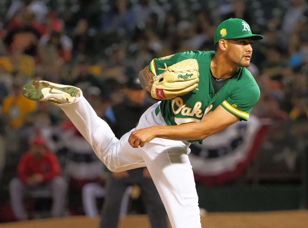 Mar 30, 2018; Oakland, CA, USA; Oakland Athletics starting pitcher Sean Manaea (55) throws against the Los Angeles Angels during the first inning at Oakland Coliseum. Mandatory Credit: Kelley L Cox-USA TODAY Sports