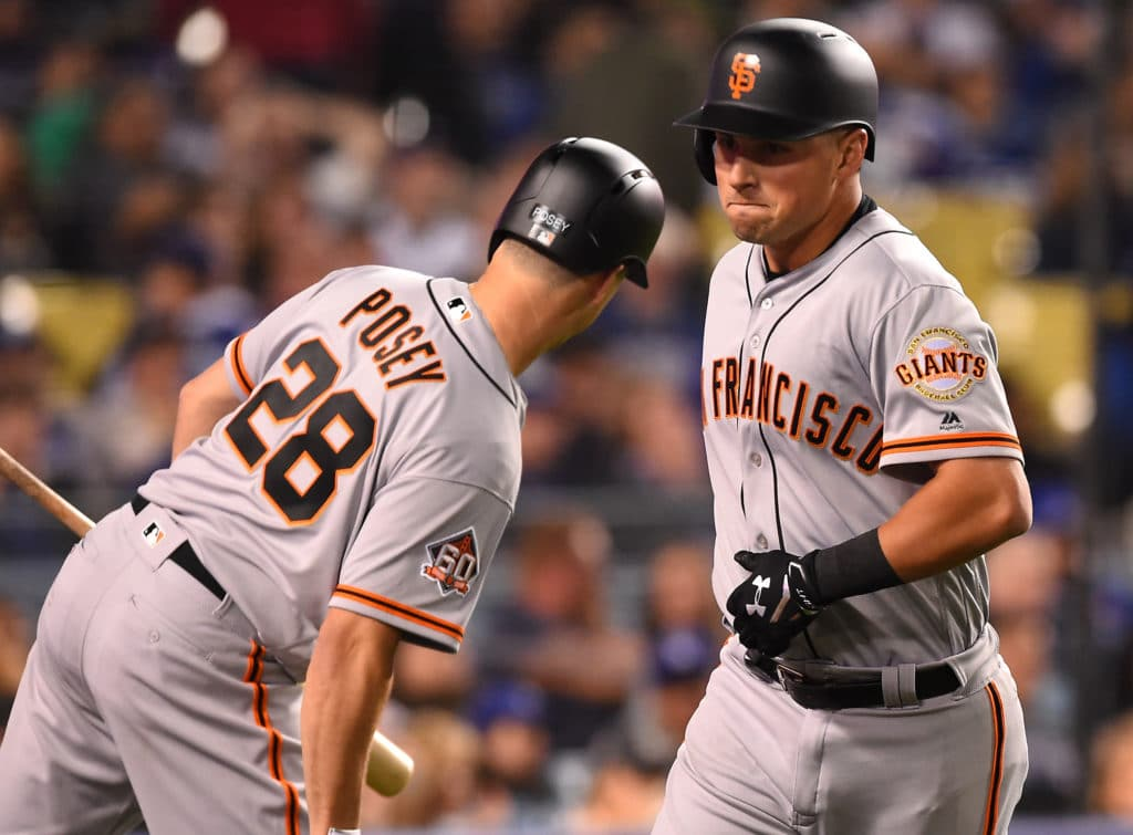 LOS ANGELES, CA - MARCH 30: Joe Panik #12 is greeted by Buster Posey #28 of the San Francisco Giants after a solo home run in the eighth inning of the game against the Los Angeles Dodgers at Dodger Stadium on March 30, 2018 in Los Angeles, California.  (Photo by Jayne Kamin-Oncea/Getty Images)