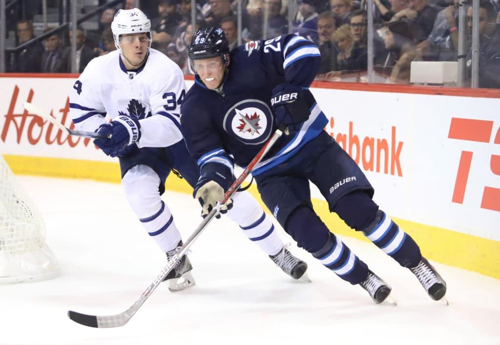 Oct 19, 2016; Winnipeg, Manitoba, CAN;  Toronto Maple Leafs center Auston Matthews (34) skates with Winnipeg Jets right wing Patrik Laine (29) during the third period against Winnipeg Jets at MTS Centre. Mandatory Credit: Bruce Fedyck-USA TODAY Sports