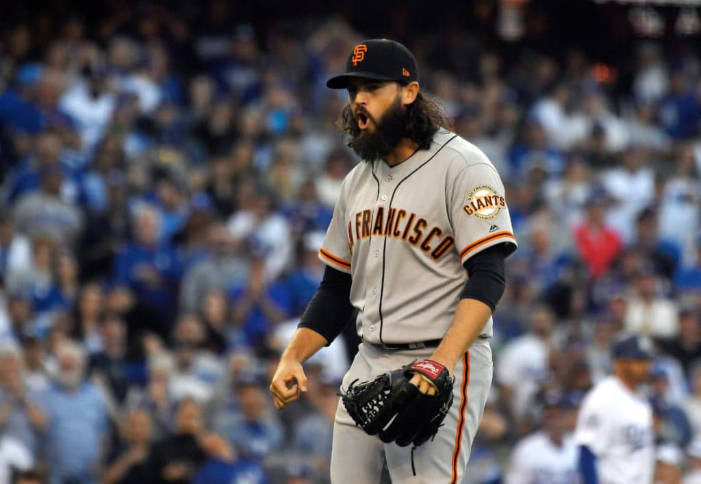 San Francisco Giants relief pitcher Cory Gearrin celebrates as he strikes out Los Angeles Dodgers' Chris Taylor during the seventh inning of an opening day baseball game Thursday, March 29, 2018, in Los Angeles.(AP Photo/Mark J. Terrill)