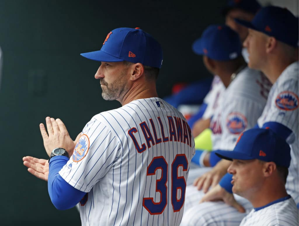 New York Mets manager Mickey Callaway (38), applauds from the dugout during pregame introductions at an opening day baseball game against the St. Louis Cardinals, Thursday, March 29, 2018, in New York. (AP Photo/Kathy Willens)