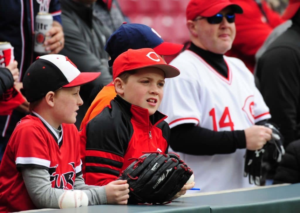 Cincinnati Reds battle the Washington Nationals in a baseball game at Great American Ball Park Friday March 30, 2018 in Downtown, Cincinnati. Two Reds fans looked on during batting practice. Photo by Joseph Fuqua II for the Athletic.com