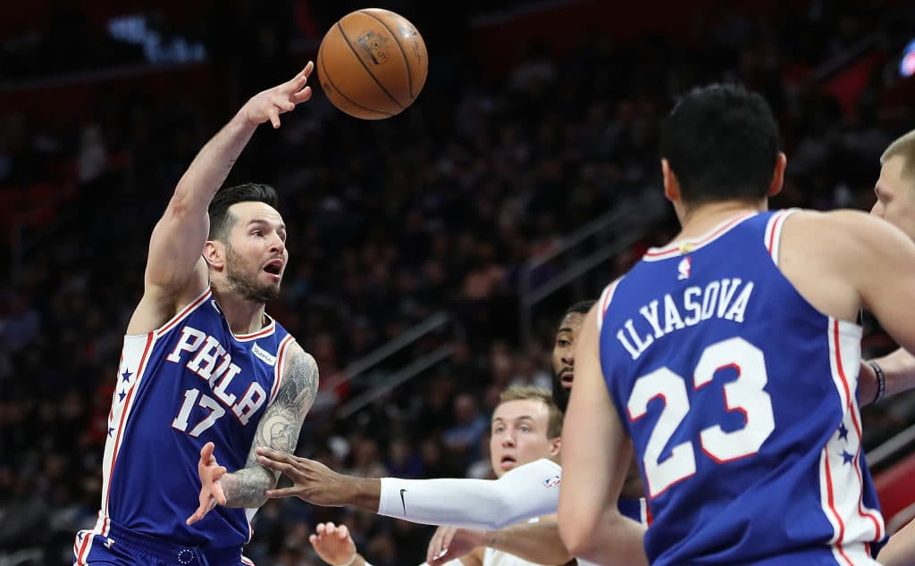 DETROIT, MI - APRIL 4: JJ Redick #17 of the Philadelphia 76ers pass the ball as her drives to the basket during the second quarter of the game against the Detroit Pistons at Little Caesars Arena on April 4, 2018 in Detroit, Michigan. NOTE TO USER: User expressly acknowledges and agrees that, by downloading and or using this photograph, User is consenting to the terms and conditions of the Getty Images License Agreement (Photo by Leon Halip/Getty Images)