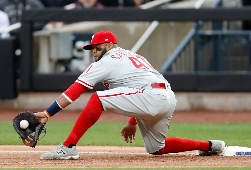 NEW YORK, NY - APRIL 04:  Carlos Santana #41 of the Philadelphia Phillies fields a throw to first base in an MLB baseball game against the New York Mets on April 4, 2018 at CitiField in the Queens borough of New York City. Mets won 4-2. (Photo by Paul Bereswill/Getty Images) *** Local Caption *** Carlos Santana